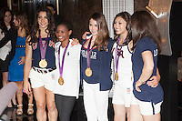 The gold medal-winning US Women's Gymnastics Team, the 'Fierce 5', flip the switch and light the Empire State Building's world-famous tower lights red, white and blue in honor of Team USA's success at the 2012 Olympic Game  in London. New York City, August 14, 2012. © Diego Corredor/MediaPunch Inc. /NortePhoto.com<br />