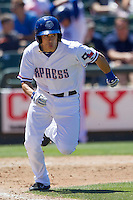 Round Rock second baseman Greg Miclat (2) runs to first base against the Nashville Sounds in the Pacific Coast League baseball game on May 5, 2013 at the Dell Diamond in Round Rock, Texas. Round Rock defeated Nashville 5-1. (Andrew Woolley/Four Seam Images).