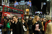 Late night Christmas shoppers in Oxford Street.