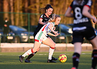 Tess Lameir (18) of OHL pictured in a duel with Romy Camps (3) of Zulte-Waregem during a female soccer game between Oud Heverlee Leuven and SV Zulte-Waregem on the 16 th matchday of the 2020 - 2021 season of Belgian Womens Super League , sunday 14 th of March 2021  in Heverlee , Belgium . PHOTO SPORTPIX.BE | SPP | DAVID CATRY