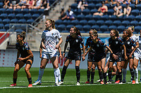 BRIDGEVIEW, IL - JUNE 5: Chicago Red Stars and North Carolina Courage players prepare for a free kick during a game between North Carolina Courage and Chicago Red Stars at SeatGeek Stadium on June 5, 2021 in Bridgeview, Illinois.