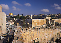 The Dome of the Rock mosque, (Al Quds - The Holy), with its golden dome, and the walls of the city under a deep blue sky, Jerusalem, Israe