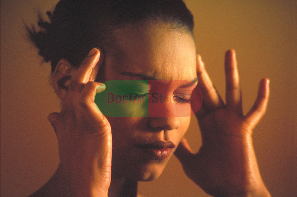 young woman with headache rubbing temples