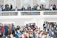 People gather to the front of the room to greet Texas senator and Republican presidential candidate Ted Cruz after he spoke at a town hall event at Peterborough Town House in Peterborough, New Hampshire, on Sun., Feb. 7, 2016.