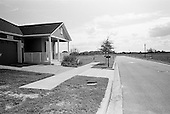 November 12, 2010<br /> Orlando, Florida<br /> <br /> A purchased home stares out at an empty subdivision in Lake Hancock, a suburb of Orlando. Although all the utilities are in place, the depressed demand for new homes has left thousands of Orlando-area lots empty.