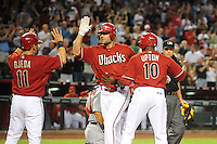 Apr. 14, 2009; Phoenix, AZ, USA; Arizona Diamondbacks batter Conor Jackson (center) is congratulated by Augie Ojeda and Justin Upton after hitting a three run home run in the eighth inning against the St. Louis Cardinals at Chase Field. The Diamondbacks defeated the Cardinals 7-6 in 10 innings. Mandatory Credit: Mark J. Rebilas-