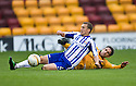 KILMARNOCK'S JAMES FOWLER AND MOTHERWELL'S KEITH LASLEY SLIDE IN FOR THE BALL