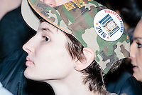 """A girl wears a camoflauge hat that says """"Make America Great Again"""" and pro-Trump and anti-Hillary and -ISIS campaign buttons in the audience before real estate mogul and Republican presidential candidate Donald Trump speaks at a rally at Exeter Town Hall in Exeter, New Hampshire, on Thurs., Feb. 4, 2016."""