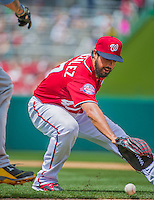 21 June 2015: Washington Nationals starting pitcher Gio Gonzalez fields an infield grounder to get Pittsburgh Pirates first baseman Corey Hart out in the 5th inning at Nationals Park in Washington, DC. The Nationals defeated the Pirates 9-2 to sweep their 3-game weekend series, and improve their record to 37-33. Mandatory Credit: Ed Wolfstein Photo *** RAW (NEF) Image File Available ***