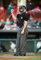 Home plate umpire Jansen Visconti makes a call during a game between the Akron RubberDucks and Erie SeaWolves on May 17, 2014 at Jerry Uht Park in Erie, Pennsylvania.  Erie defeated Akron 2-1.  (Mike Janes/Four Seam Images)