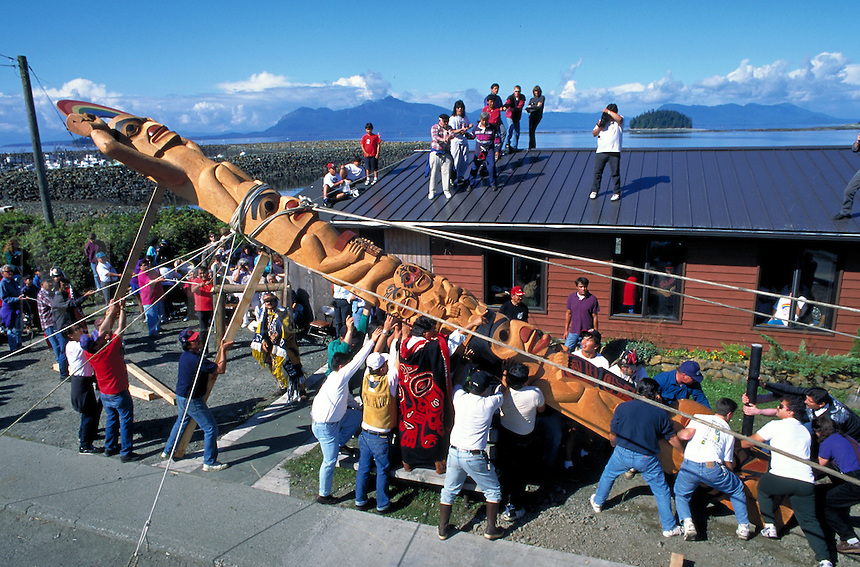 The people of Metlakatla raise the totem pole in celebration of the Potlatch.