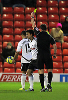 Pictured: Neil Taylor of Swansea (C) sees a yellow card from match referee Stuart Attwell. Saturday 07 January 2012<br /> Re: FA Cup football Barnsley FC v Swansea City FC at the Oakwell Stadium, south Yorkshire.
