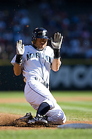 September 28, 2008: Seattle Mariners' Ichiro Suzuki slides safely into third base during a game against the Oakland Athletics at Safeco Field in Seattle, Washington.