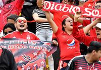 BOGOTÁ-COLOMBIA, 08-09-2019: Hinchas de América de Cali, animan a su equipo durante partido entre Millonarios y el América de Cali de ida de las semifinales por la Liga Águila Femenina  2019  jugado en el estadio Nemesio Camacho El Campín de la ciudad de Bogotá. / Fans of America de Cali, cheer for their team during a match between Millonarios and America de Cali of the semifinals for the 2019 Women's Aguila League played at the Nemesio Camacho El Campin Stadium in Bogota city, Photo: VizzorImage / Luis Ramírez / Staff.