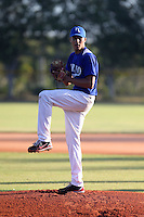 Junior Fernandez works out for scouts in Boca Chica, Dominican Republic on January 23, 2014. Fernandez later signed with the St. Louis Cardinals (Bill Mitchell)
