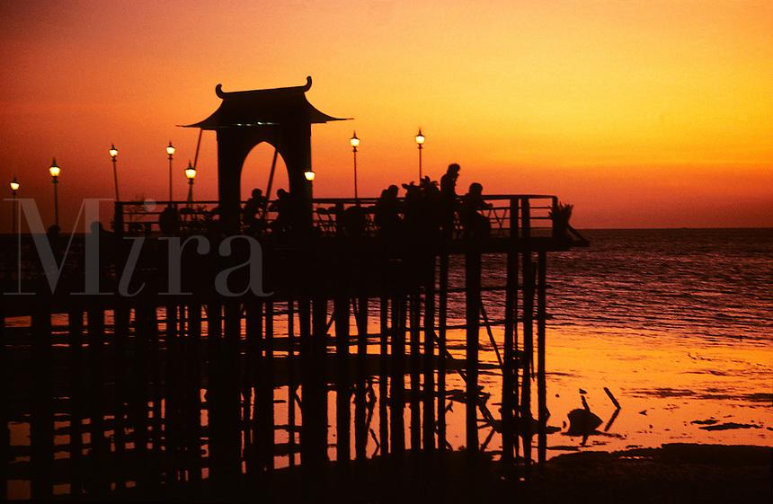 Malaysia. Kedah.  Restaurant/cafe? on rural pier at sunset.