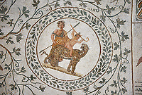 Picture of a Roman mosaics design depicting scenes from the Life of Dionysus, in this medallion Dionysus is riding a panter, from the ancient Roman city of Thysdrus, House of Silenus. Late 2nd to early 3rd century AD. El Djem Archaeological Museum, El Djem, Tunisia.