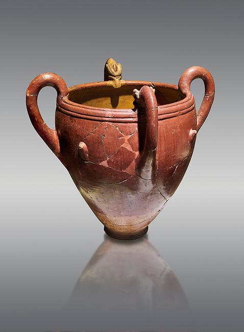 Bronze Age Anatolian four handled terra cotta vase with reliefs - 19th - 17th century BC - Kültepe Kanesh - Museum of Anatolian Civilisations, Ankara, Turkey. Against a grey background.