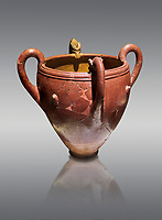 Bronze Age Anatolian four handled terra cotta vase with reliefs - 19th - 17th century BC - Kültepe Kanesh - Museum of Anatolian Civilisations, Ankara, Turkey. Against a grey background.