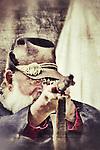 A man raises an old rifle during a Civil War reenactment in Missouri.