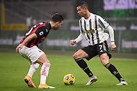 Diogo Dalot of AC Milan and Cristiano Ronaldo of Juventus FC compete for the ball during the Serie A football match between AC Milan and Juventus FC at San Siro Stadium in Milano  (Italy), January 6th, 2021. Photo Federico Tardito / Insidefoto