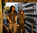 London, UK. 09.10.2021. Two people walk under a bridge, in the late afternoon, October, sun, Camden, London. Photograph © Jane Hobson.
