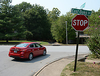 A car turns right Friday, Sept. 10, 2021, onto East Oaks Drive from Kantz Drive in Fayetteville. The city will install seven speed cushions along East Oaks and Kantz drives as part of an updated policy on traffic calming in neighborhoods. Speed cushions are prefabricated, usually made of hard rubber, with gaps widely spaced apart so the wheels of fire trucks can pass through. Visit nwaonline.com/210912Daily/ for today's photo gallery.<br /> (NWA Democrat-Gazette/Andy Shupe)