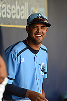 Charlotte Stone Crabs pitcher Leonel Santiago (14) in the dugout during a game against the Fort Myers Miracle on April 16, 2014 at Charlotte Sports Park in Port Charlotte, Florida.  Fort Myers defeated Charlotte 6-5.  (Mike Janes/Four Seam Images)