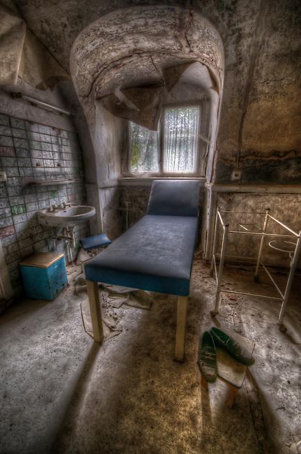 Examination room in a small hospital.