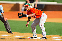 First baseman Harold Martinez #9 of the Miami Hurricanes waits for a pick off throw against the Wake Forest Demon Deacons at Gene Hooks Field on March 19, 2011 in Winston-Salem, North Carolina.  Photo by Brian Westerholt / Four Seam Images