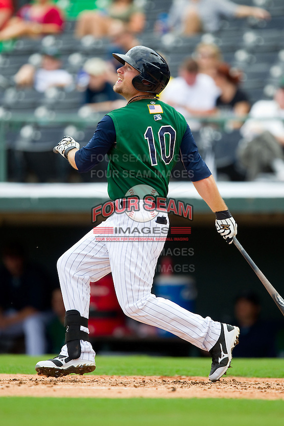 Jim Gallagher (10) of the Charlotte Knights follows through on his swing against the Durham Bulls at Knights Stadium on August 18, 2013 in Fort Mill, South Carolina.  The Bulls defeated the Knights 8-5 in Game One of a double-header.  (Brian Westerholt/Four Seam Images)