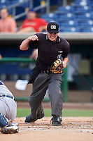 Lakeland Flying Tigers umpire Dave Attridge calls out Derek Campbell (not shown) after being tagged out by catcher Kade Scivicque (not shown) during a game against the Clearwater Threshers on August 5, 2016 at Bright House Field in Clearwater, Florida.  Clearwater defeated Lakeland 3-2.  (Mike Janes/Four Seam Images)