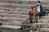 Nepal, Pashupatinath.  Cremation Stages.  Shaving the Head of the Senior Mourner, usually the Eldest Son, after  cremating an elder relative.