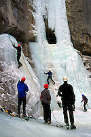 Ice Climbers learning to climb on Frozen Waterfall at Ice Climbing Clinic, Marble Canyon Provincial Park, Southwestern British Columbia, Canada