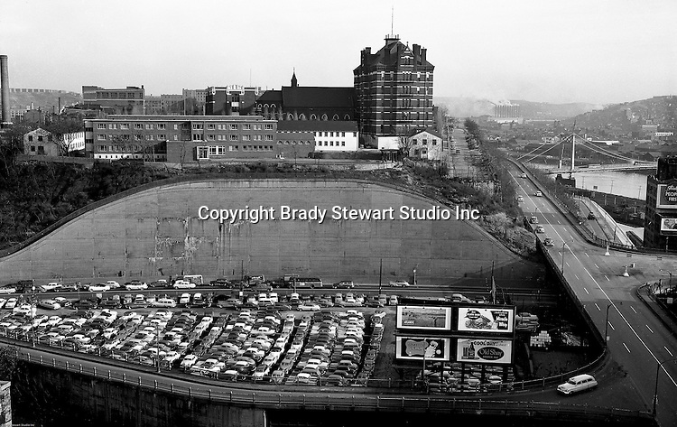Pittsburgh PA:  View of Duquesne University, future crosstown parkway, Liberty Bridge entrance, and Boulevard of the Allies from a building rooftop.