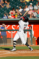 Lansing Lugnuts outfielder Chavez Young (2) follows through on a swing during a game against the Dayton Dragons at Cooley Law School Stadium on August 10, 2018 in Lansing, Michigan. Lansing defeated Dayton 11-4.  (Robert Gurganus/Four Seam Images)