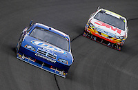 Feb 22, 2009; Fontana, CA, USA; NASCAR Sprint Cup Series driver Kurt Busch leads Greg Biffle during the Auto Club 500 at Auto Club Speedway. Mandatory Credit: Mark J. Rebilas-