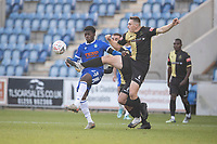 Alex Doyle, Marine AFC clears under pressure from Kwame Poku, Colchester United during Colchester United vs Marine, Emirates FA Cup Football at the JobServe Community Stadium on 7th November 2020