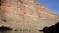 Nine of the 12 canoes are visible as they float the San Juan River through Slickhorn Canyon in southeast Utah. Sixteen people, including 12 canoes and a raft carrying four, paddle 83.5 miles of the San Juan River from the Sand Island Boat Ramp near Bluff, Ut., to Clay Hills Crossing UT.. Check out nwaonline.com/21____Daily/ and nwadg.com/photos for a photo gallery.<br /> (NWA Democrat-Gazette/David Gottschalk)