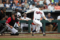 Auburn Tigers outfielder Judd Ward (1) follows through on his swing during Game 7 of the NCAA College World Series against the Louisville Cardinals on June 18, 2019 at TD Ameritrade Park in Omaha, Nebraska. Louisville defeated Auburn 5-3. (Andrew Woolley/Four Seam Images)