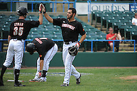 University of Louisville Cardinals outfielder Jeff Gardner (42) is greeted by team mate Colin Lyman (35) after he hits a home run during a game against the Temple University Owls at Campbell's Field on May 10, 2014 in Camden, New Jersey. Temple defeated Louisville 4-2.  (Tomasso DeRosa/ Four Seam Images)
