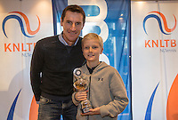 Hilversum, Netherlands, December 4, 2016, Winter Youth Circuit Masters, 3 th place boys 12 years Niels Roemelink with Fedcup captain Paul Haarhuis.   <br /> Photo: Tennisimages/Henk Koster