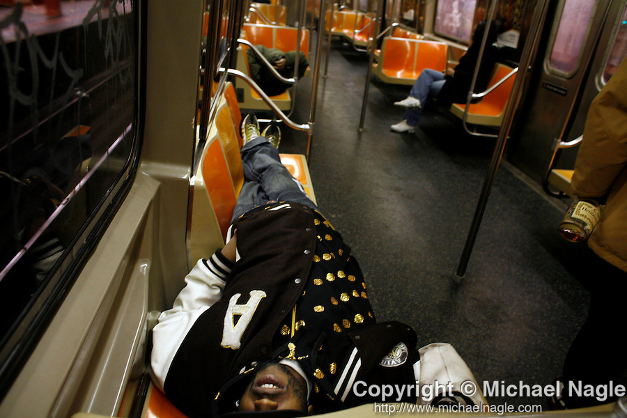 NEW YORK - MARCH 19, 2007:  A man takes a nap on a subway train after a night  on the town with Hennessy and friends on March 17, 2007 in New York City. (PHOTOGRAPH BY MICHAEL NAGLE)