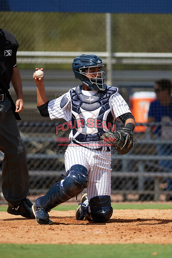 New York Yankees catcher Hemmanual Rosario (15) throws the ball back to the pitcher during an Instructional League game against the Baltimore Orioles September 23, 2017 at the Yankees Minor League Complex in Tampa, Florida.  (Mike Janes/Four Seam Images)
