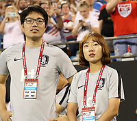CHARLOTTE, NC - OCTOBER 3: Assistant coaches Dongcheol Seol and Jihoe Kim of Korea Republic during a game between Korea Republic and USWNT at Bank of America Stadium on October 3, 2019 in Charlotte, North Carolina.