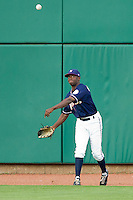 Derrick Robinson (9) of the Northwest Arkansas Naturals throws a ball back into the infield during a game against the San Antonio Missions at Arvest Ballpark on June 30, 2011 in Springdale, Arkansas. (David Welker / Four Seam Images)
