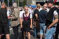 """Ueber 1.000 Rechtsextreme aus mehreren Bundeslaendern demonstrieren am Samstag den 19. August 2017 in Berlin zum Gedenken an den Hitler-Stellvertreter Rudolf Hess.<br /> Rudolf Hess hatte am 17. August 1987 im Alliierten Kriegsverbrechergefaengnis in Berlin Spandau Selbstmord begangen. Seitdem marschieren Rechtsextremisten am Wochenende nach dem Todestag mit sog. """"Hess-Maerschen"""".<br /> Weit ueber 1.000 Menschen protestierten gegen den Aufmarsch der Rechtsextremisten und stoppten den Hess-Marsch nach 300 Metern u.a. mit Sitzblockaden. Der rechtsextreme Aufmarsch wurde daraufhin von der Polizei umgeleitet.<br /> Aus dem Aufmarsch wurden mehrfach Gegendemonstranten angegriffen, mindestens ein Neonazi wurde festgenommen.<br /> Im Bild: Antje Mentzel aus Mecklenburg-Vorpommern. Sie ist Vorsitzende der NPD-Untergruppierung """"Ring Nationaler Frauen"""" (RNF)<br /> 19.8.2017, Berlin<br /> Copyright: Christian-Ditsch.de<br /> [Inhaltsveraendernde Manipulation des Fotos nur nach ausdruecklicher Genehmigung des Fotografen. Vereinbarungen ueber Abtretung von Persoenlichkeitsrechten/Model Release der abgebildeten Person/Personen liegen nicht vor. NO MODEL RELEASE! Nur fuer Redaktionelle Zwecke. Don't publish without copyright Christian-Ditsch.de, Veroeffentlichung nur mit Fotografennennung, sowie gegen Honorar, MwSt. und Beleg. Konto: I N G - D i B a, IBAN DE58500105175400192269, BIC INGDDEFFXXX, Kontakt: post@christian-ditsch.de<br /> Bei der Bearbeitung der Dateiinformationen darf die Urheberkennzeichnung in den EXIF- und  IPTC-Daten nicht entfernt werden, diese sind in digitalen Medien nach §95c UrhG rechtlich geschuetzt. Der Urhebervermerk wird gemaess §13 UrhG verlangt.]"""