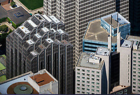 aerial photograph of the tops of several San Francisco skyscrapers in the heart of the financial district including 345 California Center (right front), Embarcadero West (275 Battery Street)(left center), One Embarcadero Center (background), 353 Sacramento Street (blue office tower middle right), San Francisco, California