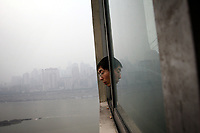CHINA. Sichuan Province. Chongqing. The Yangtze which is at its lowest level in 150 years as a result of a country-wide drought. Chongqing is a city of over 3,000,000 people, famed for being the capital of China between 1938 and 1946 during World War II. It is situated on the banks of the Yangtze river, China's longest river and the third longest in the world. Originating in Tibet, the river flows for 3,964 miles (6,380km) through central China into the East China Sea at Shanghai.  2008