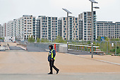 A security guard on patrol. London 2012 Olympic Park and Athletes' Village, Stratford.